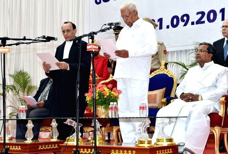Chief Justice of Karnataka High Court  D H Waghela administers oath of office to newly appointed Karnataka Governor Vajubhai Rudabhai Vala as the Governor of the state at Raj Bhavan in Bangalore on ..