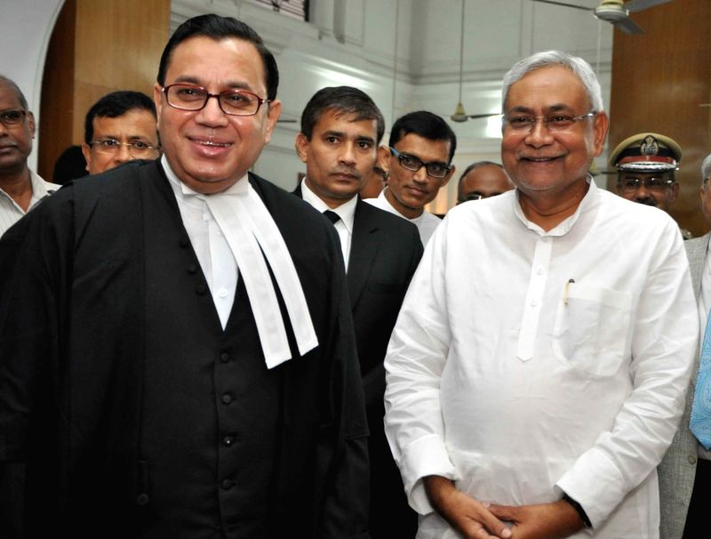 Chief Justice of Patna High Court Justice Iqbal Ahmed Ansari with Bihar Chief Minister Nitish Kumar in Patna on July 29, 2016. - Nitish Kumar