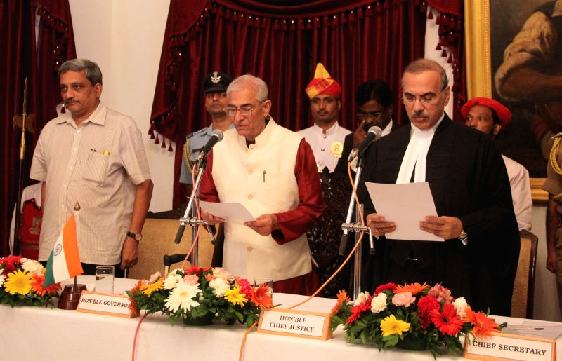 Chief Justice of the Bombay High Court, Mohit Shah administers oath of office as Governor of Goa to Gujarat Governor Om Prakash Kohli during a swearing-in ceremony at Raj Bhavan in Donapaula on Aug .. - Mohit Shah and Prakash Kohli