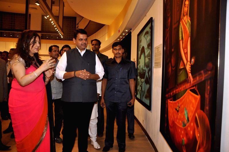 Chief Minister Devendra Fadnavis during the inauguration of art exhibition Divinity by artist Dr Archana Srivastava in Mumbai on Dec 1, 2014. - Devendra Fadnavis