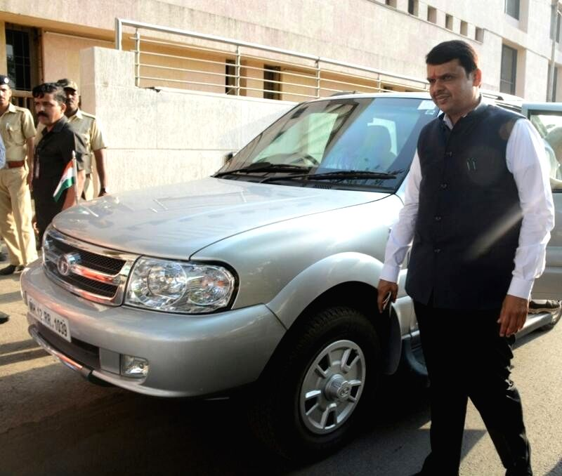 Chief Minister Devendra Fadnavis removes beacon from his car in Mumbai, on April 19, 2017. In an effort to do away with VIP culture in India, the government on Wednesday announced official ... - Devendra Fadnavis