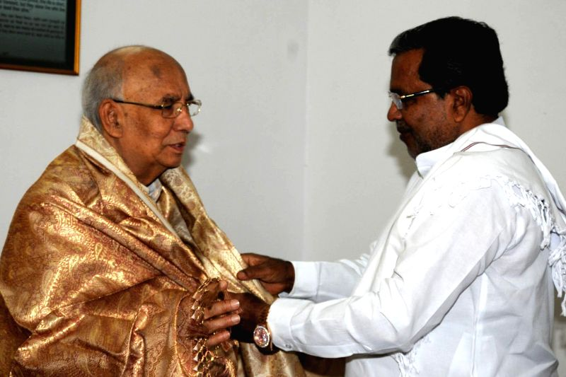 Chief Minister K Siddaramaiah felicitated Governor HR Bhardwaj during his visit to Raj Bhavan, in Bangalore on June 28, 2014.