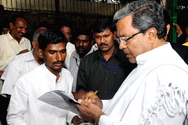 Chief Minister K Siddaramaiah listening to public grievances during the Janata Darshan, at Home Office, Krishna, in Bangalore on July 5, 2014.