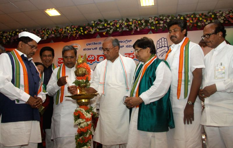 Chief Minister K Siddaramaiah with KPCC President G Parmeshwar, Congress Karnataka incharge Digvijaya Singh, MP Janardhan Poojary and others seen lighting lamp to inaugurate the Congress ... - K Siddaramaiah and Digvijaya Singh