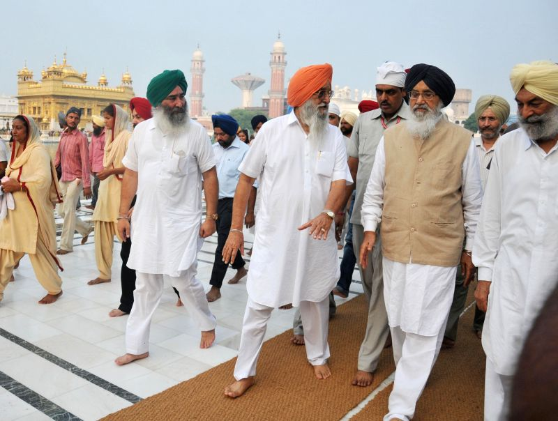 Chief Minister Parkash Singh Badal going to attend SAD (B)`s core committee meeting before paying obeisane at Golden Temple on July 26, 2014.