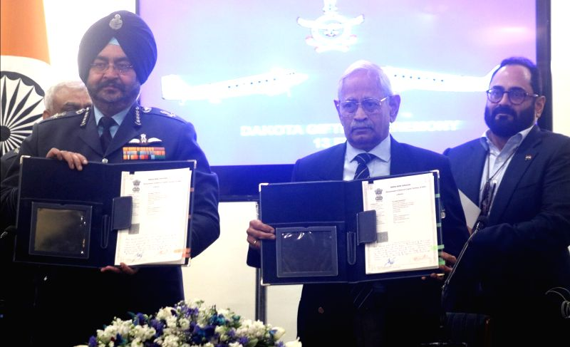 Chief of Air Staff Air Chief Marshal Birender Singh Dhanoa and retired Air Commodore M.K. Chandrasekhar during the signing of a gift deed to handover Dakota DC-3 Aircraft in New Delhi on ...