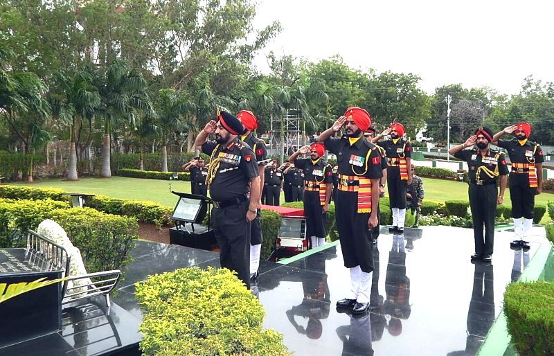 Chief of Army Staff General Bikram Singh pays homage to martyrs, at the Infantry War Memorial during his farewell visit to the Infantry School, Mhow in Indore on July 10, 2014.