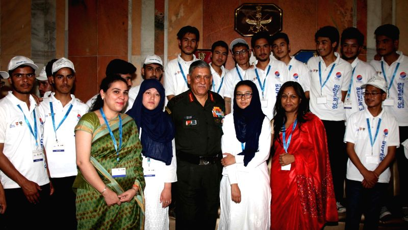 Chief of Army Staff General Bipin Rawat with the students from Jammu and Kashmir (supported by 'Kashmir Super 30' Project) who have qualified for the JEE (Main & Advance) 2017-18, ...