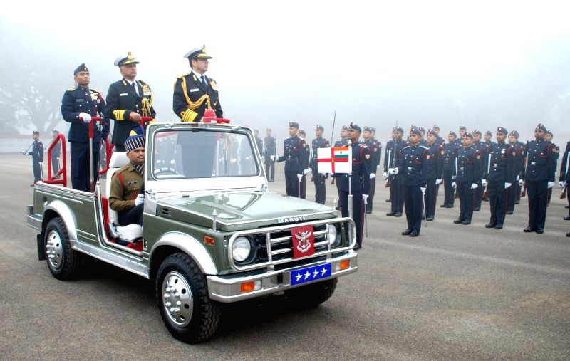 Chief of Naval Staff, Admiral R K Dhowan inspects the Guard of Honour at the Passing-out parade, at National Defence Academy (NDA), Khadakwasla, in Pune on Nov 28, 2015.