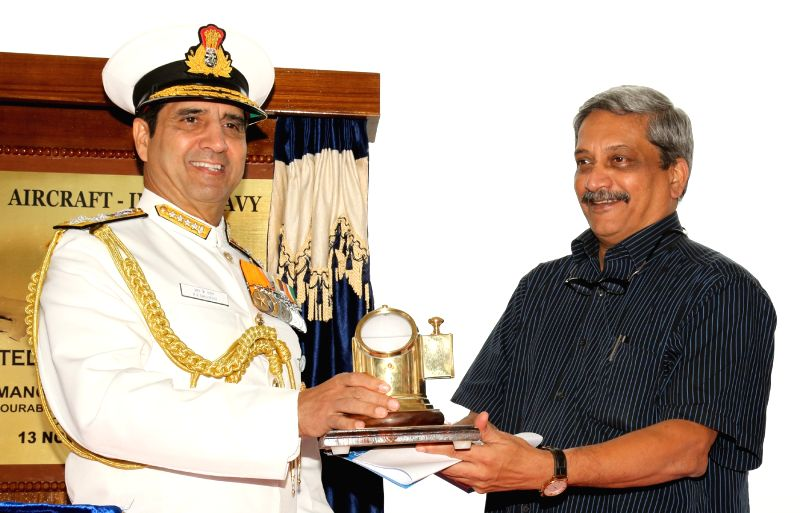 Chief of Naval Staff, Admiral RK Dhowan presents a memento to Defence Minister Manohar Parrikar at the Induction Ceremony of P8i Aircraft at INS Rajali near Chennai on Nov. 13, 2015.