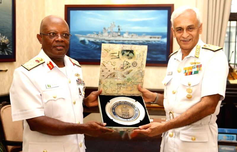 Chief of Naval Staff, Admiral Sunil Lanba exchanges memento with the Chief of the Naval Staff, Nigerian Navy, Vice Admiral Ibok-Ete Ekwe Ibas, in New Delhi on July 16, 2018.