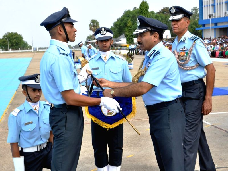 Chief of the Air Staff, Air Chief Marshal Arup Raha presenting the Sword of Honor to flying officer Anil Kumar during the Graduation Parade at Air Force Academy, Dundigal, in Hyderabad on June 21, ... - Kumar