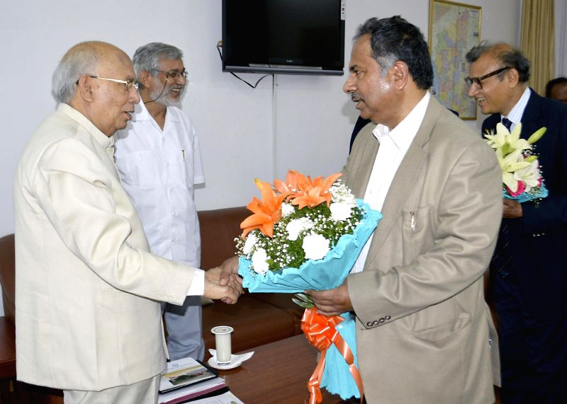 Chief Secretary Kaushik Mukherji greets out-going Karnataka Governor HR Bharadwaj at Raj Bhavan, in Bangalore on June 28, 2014.