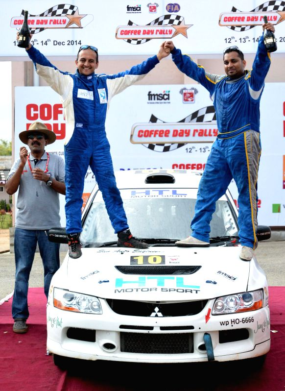 Rally drivers Vikram Mathias and Swaroop Mohan celebrate after winning the Coffee Day Rally in Chikmagalur.