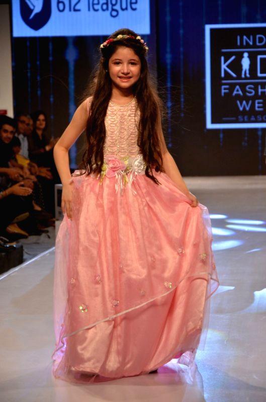 Child actor Harshaali Malhotra walks the ramp during India Kids Fashion Week 2016, in Mumbai on June 03, 2016. - Harshaali Malhotra