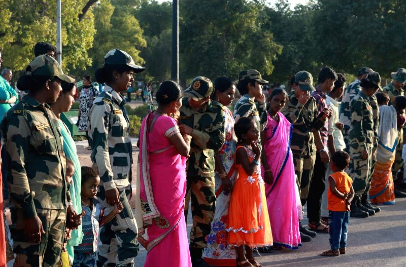 Child Rights and CRY activists along with Delhi Police and BSF personnel form a human chain to spread awareness against child labour on World Day Against Child Labour in New Delhi on June ...