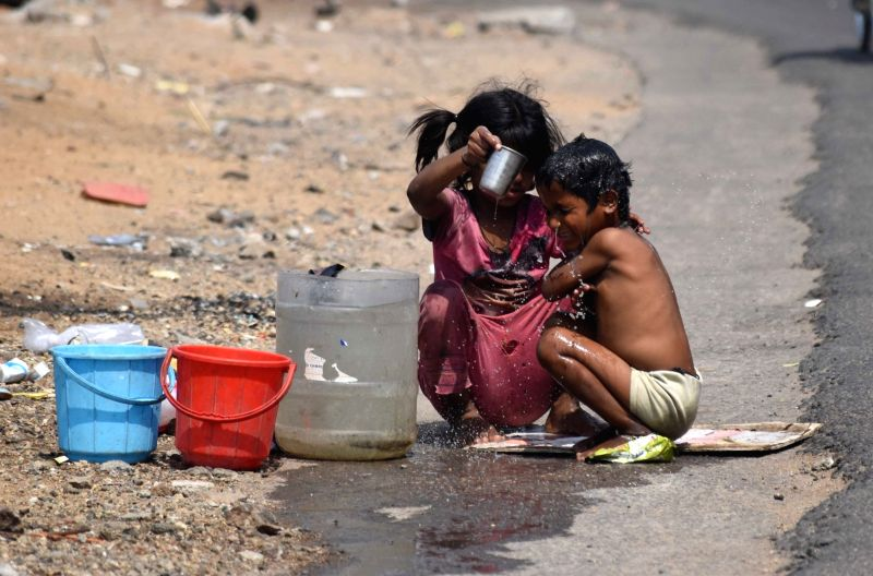 Children bath in open on a hot day in Hyderabad on April 17, 2017.