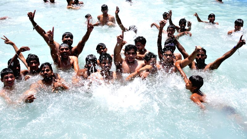 Children beat the heat in a swimming pool on a hot day in Amritsar on June 3, 2017.