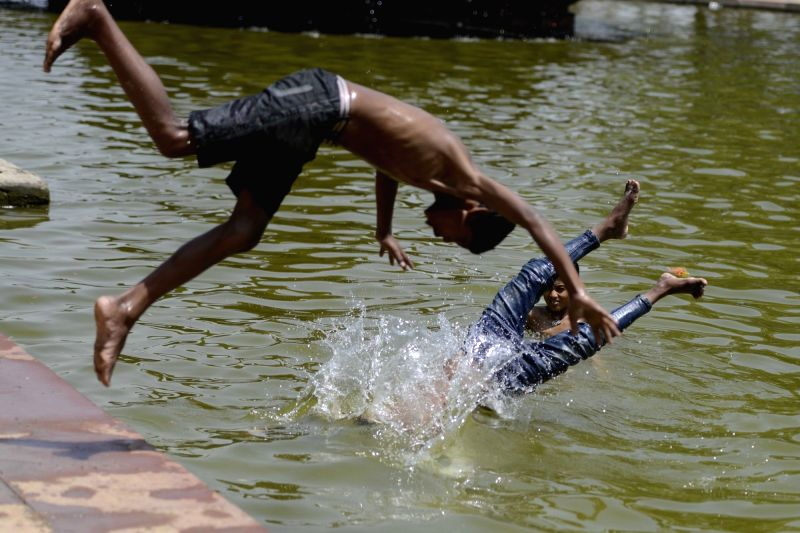 Children beat the heat on a hot day in New Delhi on May 16, 2016.