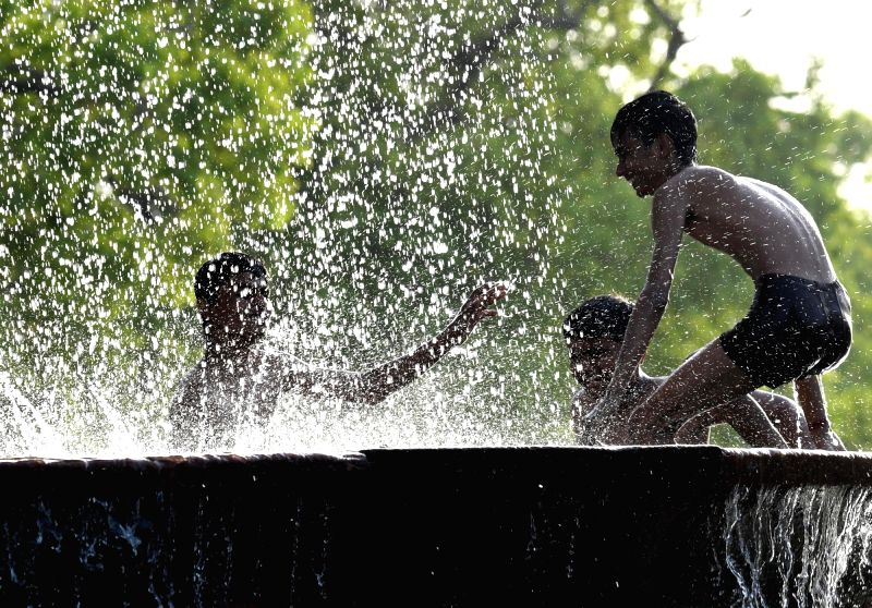 Children beat the heat on a hot day in New Delhi on April 20, 2017.