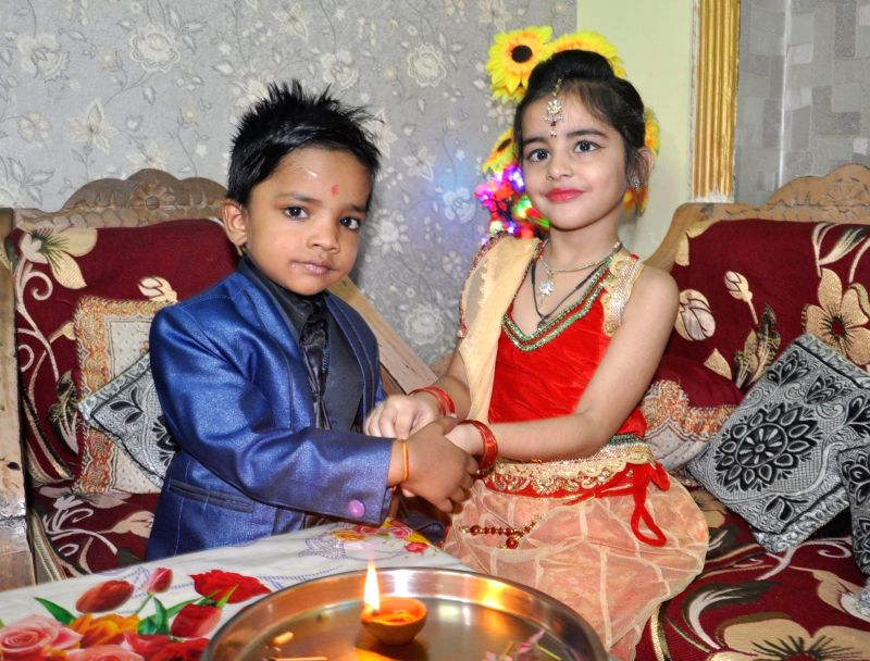 Children celebrate Bhai Dooj in New Delhi.