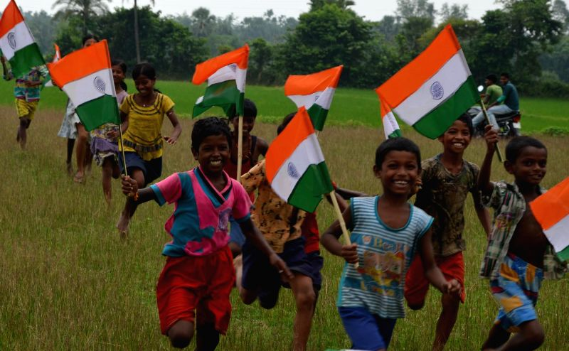 Children celebrate on the eve of Independence Day in Malda on Aug 14, 2014.