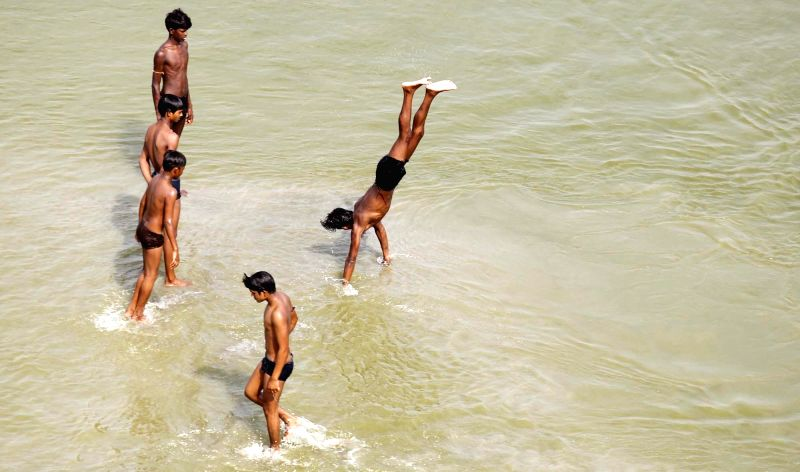 Children cool themselves in Ganga river on a hot day in Allahabad on May 25, 2017.