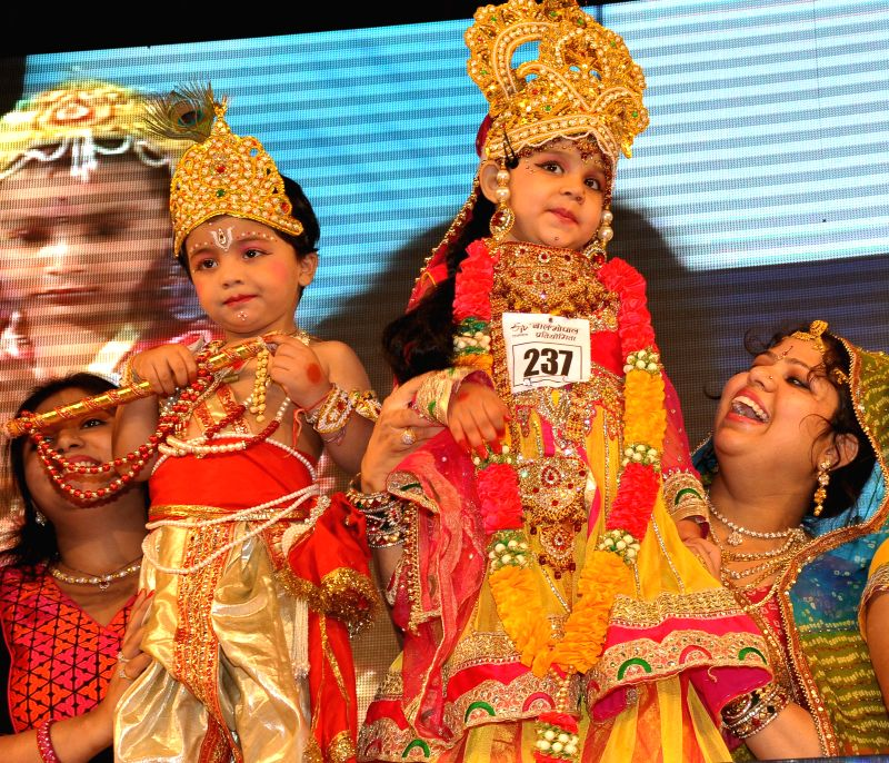 Children disguised as lord Krishna and Radha during a Janmashtami programme organised at Birla Auditorium in Jaipur on Aug 17, 2014.