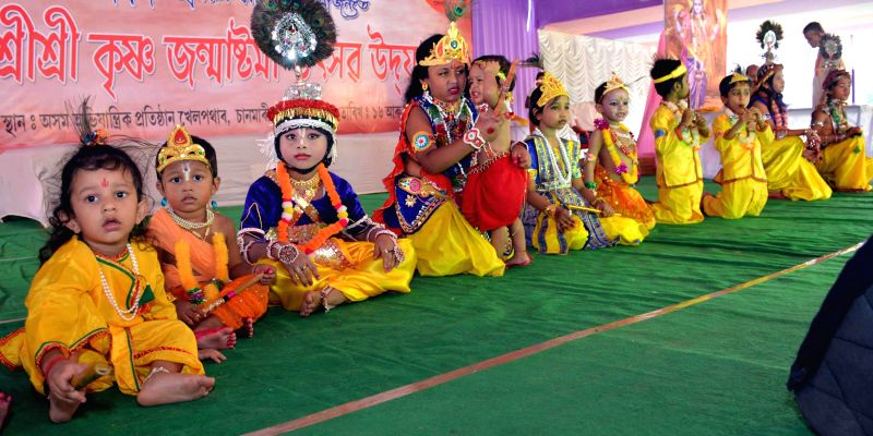 Children disguised as lord Krishna and Radha during a Janmashtami programme organised by Vishwa Hindu Parishad in Guwahati on Aug 17, 2014.