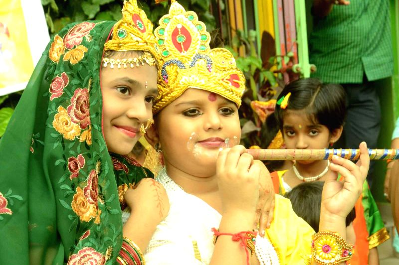 Patna: Children disguised as lord Krishna and Radha during a Janmashtami programme in Patna, on Sep 2, 2015.