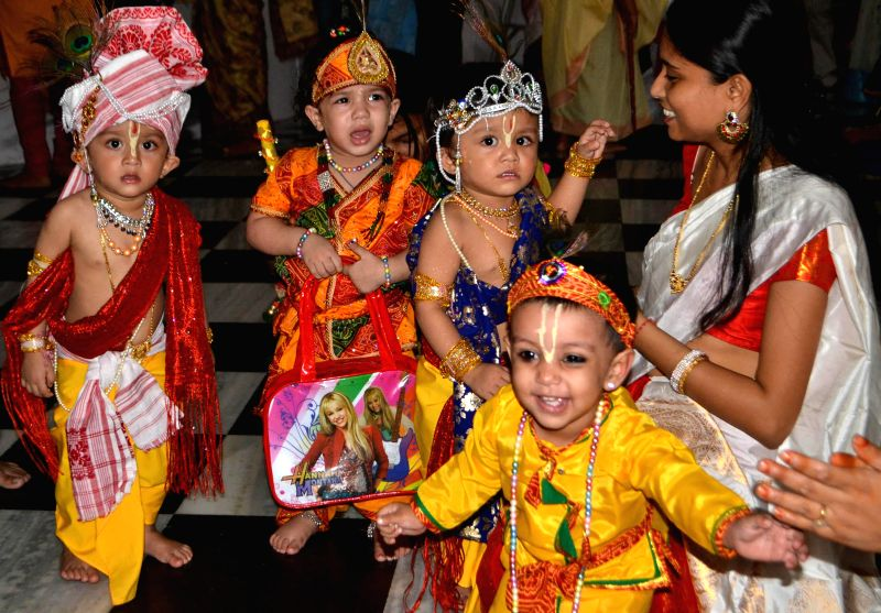 Children disguised as lord Krishna and Radha at ISKCON temple in Guwahati on Aug 17, 2014.