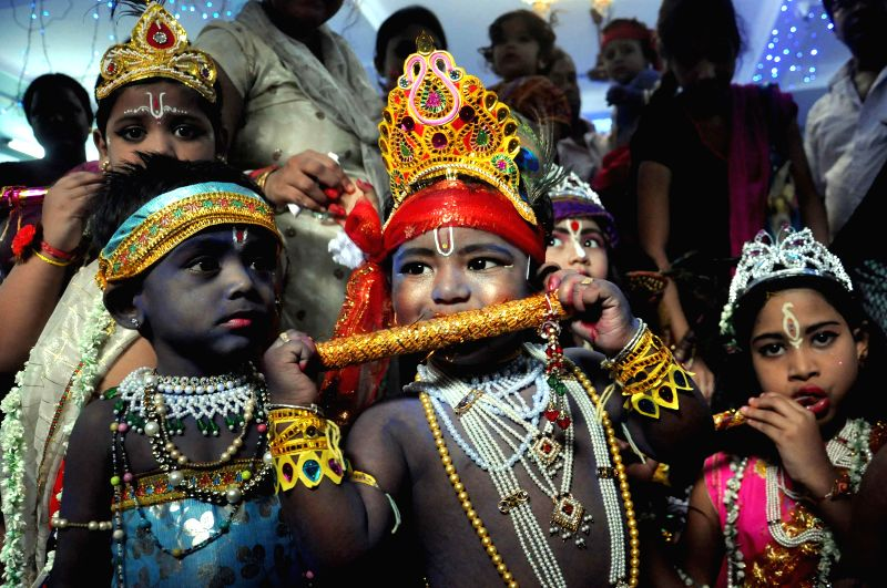 Children disguised as lord Krishna and Radha on Janmashtami in Kolkata on Aug 17, 2014.