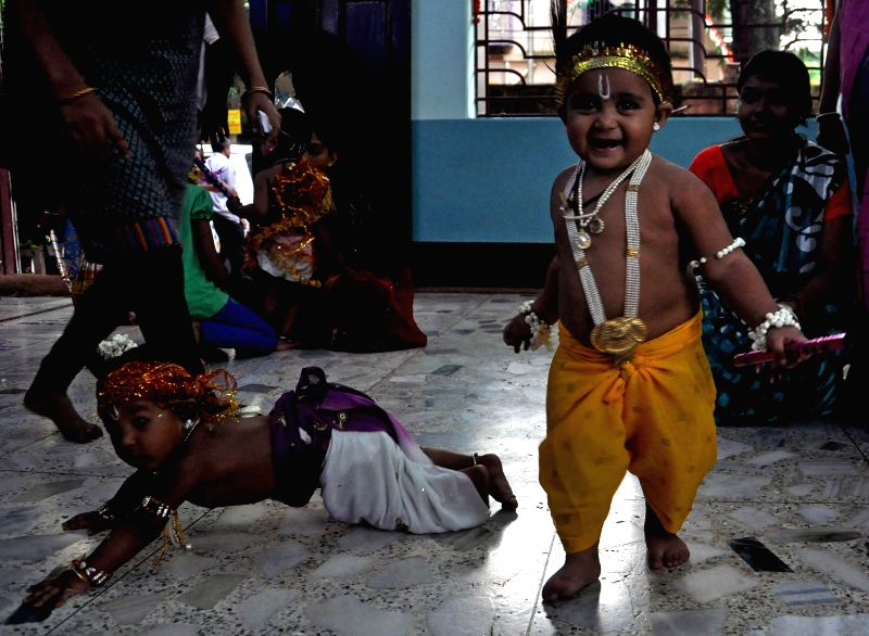 Children disguised as lord Krishna on Janmashtami in Kolkata on Aug 17, 2014.