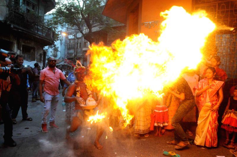 Children dresses as lord Shiva and goddess Kali during Ganjan Festival in Kolkata, on April 13, 2018.