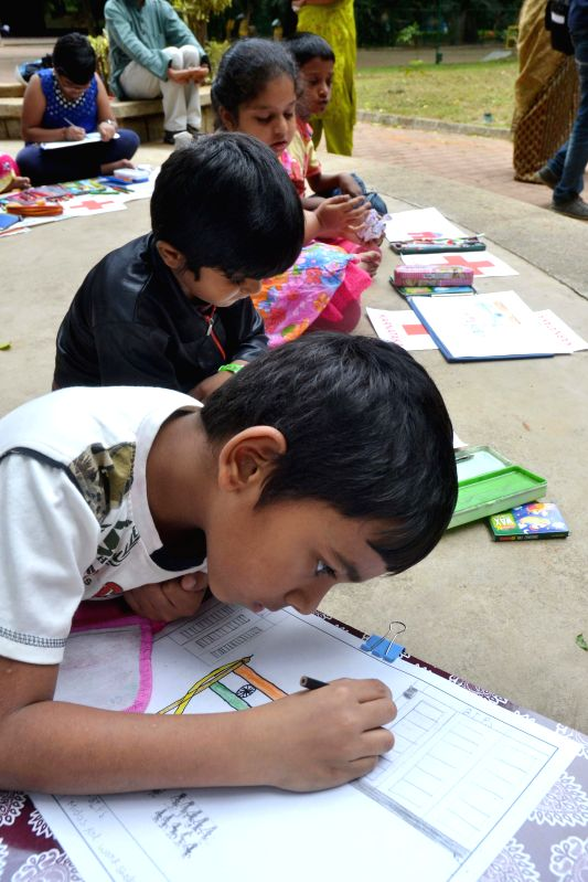 Children during `India of My Dreams`, a painting competition organised by Indian Red Cross Society in Bangalore on Aug 3, 2014.