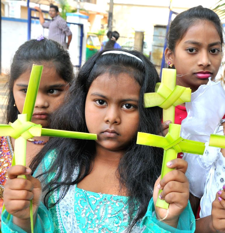 Children during Palm Sunday feast in Bangalore on April 13, 2014. Palm Sunday is a Christian feast that is observed on the Sunday before Easter. The feast commemorates Jesus' triumphal entry into ...