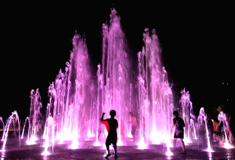 Children enjoy a fountain at a park in Yeosu, South Jeolla Province, on Aug. 2, 2017, amid scorching heat.