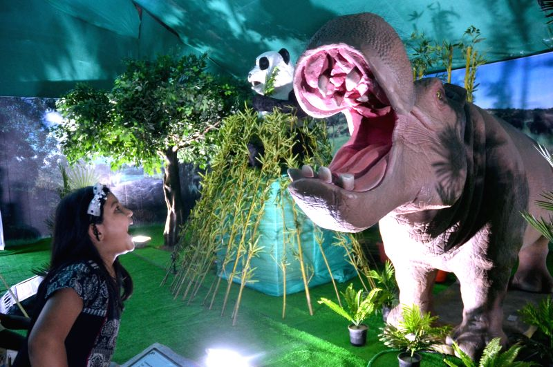 Children enjoy a robotic wild animal show at the National Consumer Fair at St Josephs Indian High School in Bengaluru on May 6, 2017.