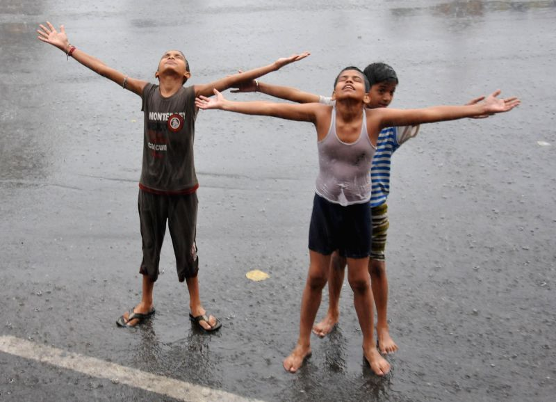 Children enjoy rains in Amritsar on June 25, 2014.