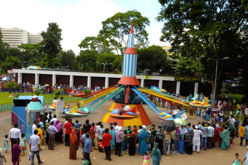 Children enjoy rides at Dhaka `Shishu Park` a day after the Eid-ul-Fitr in Bangladesh on July 30, 2014.
