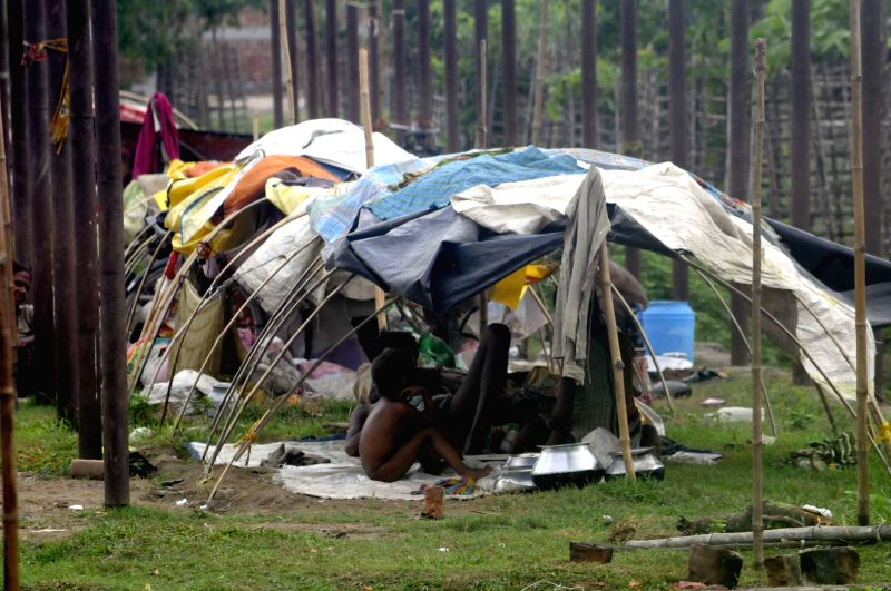 Children forced to live in a tent in wake of Kosi flood alerts in Supaul district of Bihar on Aug 3, 2014.