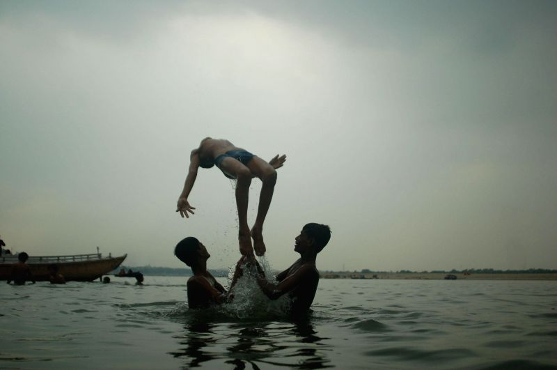 Children having fun during a bath in Ganga in Varanasi.