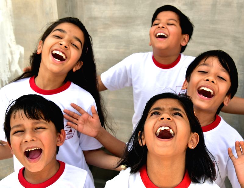 Children laugh on World Laughter Day in Bikaner on May 7, 2017.