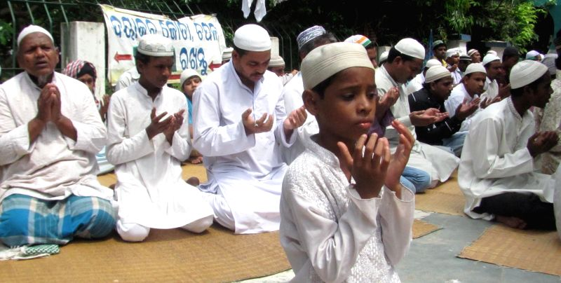 Children offer Namaz on Juma-tul-Vida, the last Friday of the holy month of Ramadan at a mosque during Ramadan in Cuttack on July 25, 2014.