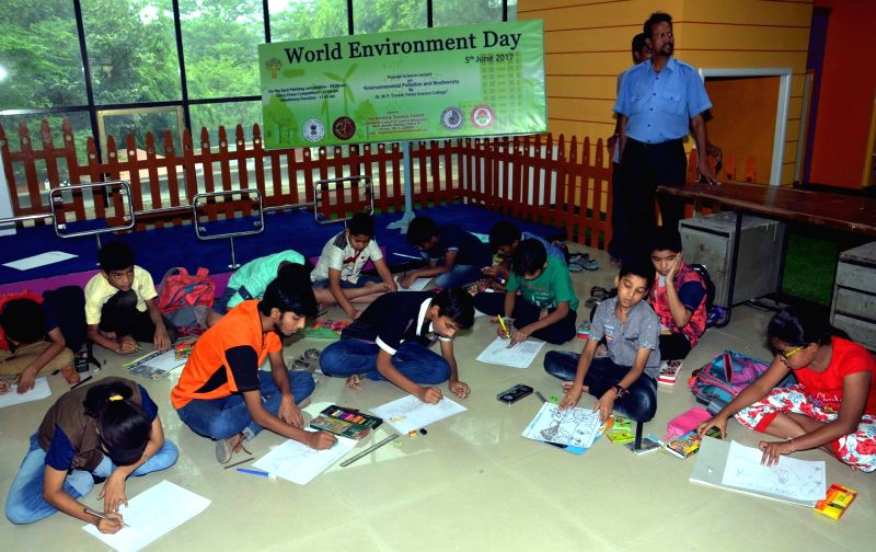 Children participate during a painting competition organised on World Environment Day in Patna on June 5, 2017.
