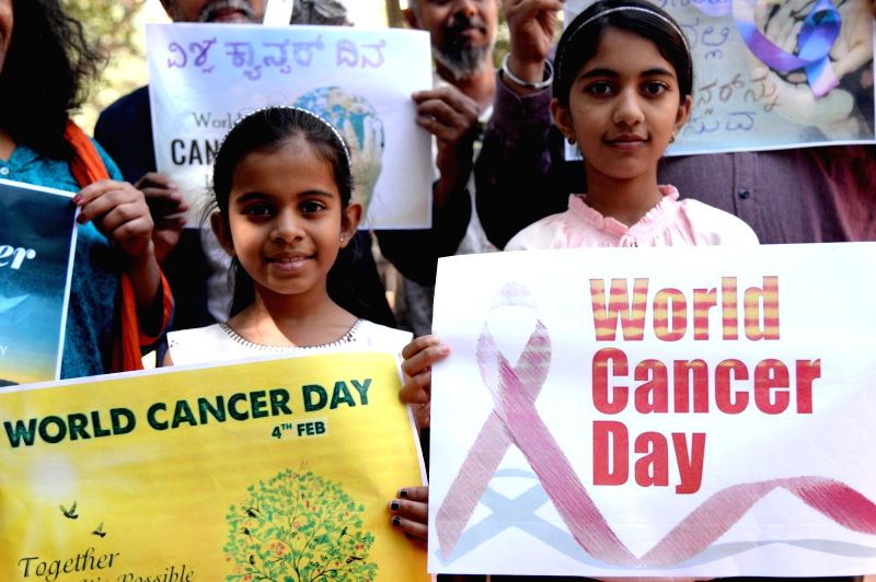 Children participate in a cancer awareness programme ahead of World Cancer Day in Bengaluru on Feb 2, 2018. World Cancer Day is observed on Feb 4.