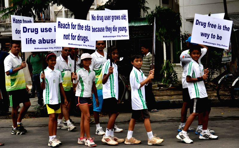 Children participate in a rally organised on United Nations' International Day Against Drug Abuse and Illicit Trafficking in Kolkata on June 26, 2014.