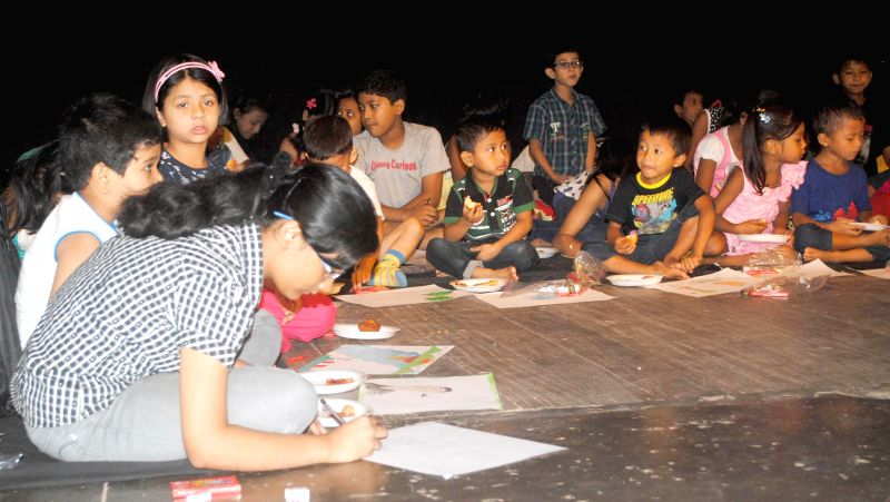 Children participate in a sit and draw competition organised at Rabindra Bhawan in Guwahati on July 14, 2014.