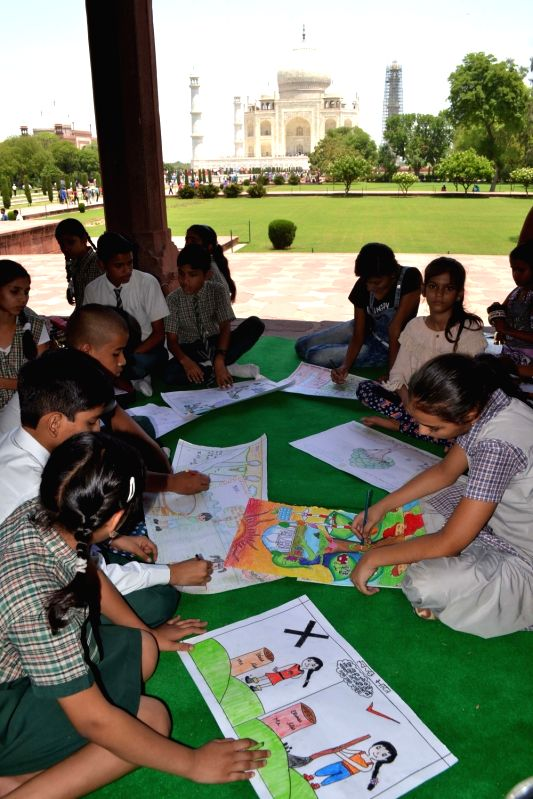 Children participate in a sit and draw competition organised by ASI om World Museum Day in Agra on May 18, 2017.