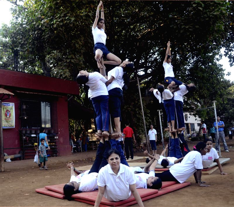 Children participate in a summer fitness camp at Shivaji Park in Mumbai on April 29, 2014.